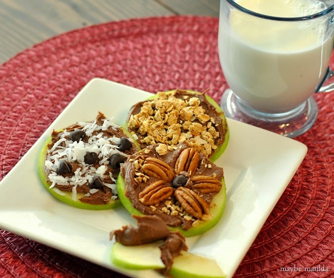 Build Your Own Apple Snack Bar with apple rings, Reese's Spreads, and toppings. Kids can top however they like for a fun, unique snack.