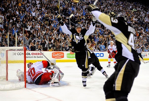 Evgeni-Malkin-71-of-the-Pittsburgh-Penguins-reacts-toward-Philippe-Boucher-43