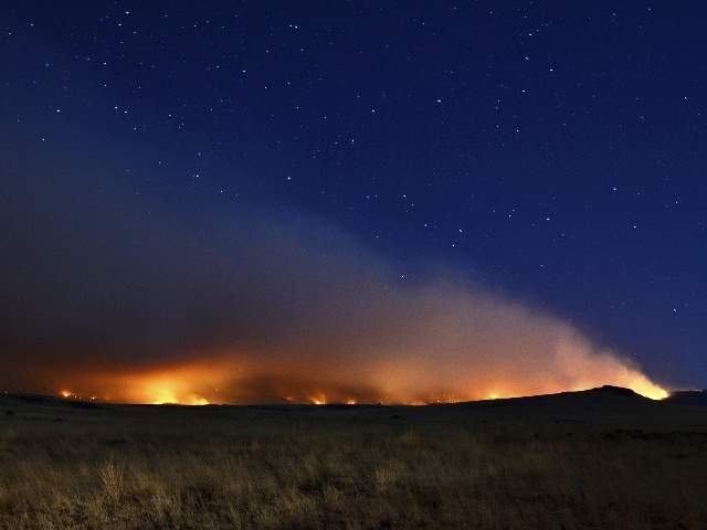 The Wallow Fire lights the night skies near Springerville, 9 June 2011. Eric English