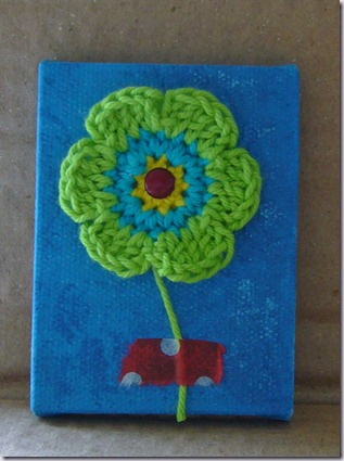 gehaakte-bloem-op-canvas