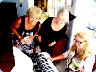 Jan Johnston and Delyse Whorwood taking a keen interest in Desiree Barrows playing using the Korg Pa3X