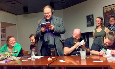 Tuomas reads, Shimo and Arren sign the books