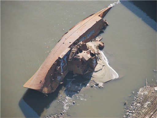 The drought revealed this WWII minesweeper, seen here on 28 November 2012 on the Mississippi River near St. Louis, Missouri. Colby Buchanan, US Coast Guard, via AP