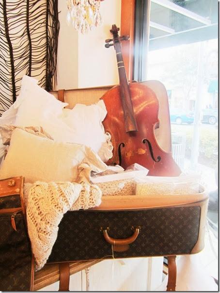 cococozy vintage louis vuiton luggage in store window pom pom