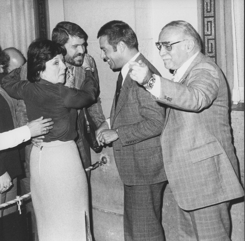 Councilwowan Peggy Stevenson, Reverend Troy Perry, Councilman Joel Wachs, and Dr. Newton Deiter (from left to right) celebrate after the passage of a gay rights bill by the Los Angeles city council. 1979.