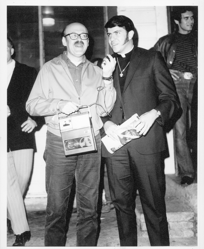 "Reverend Troy Perry (right) at a Gay Liberation Front (GLF) protest at Barney's Beanery regarding their posting of ""Fagots [sic] Stay Out"" signs. 1969."