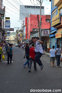 Davao blogger Faust jumps for a shot, along Crooked Road / Ponciano Street