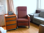 Room 5531, guest armchair and night table