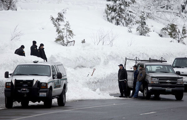 Emergency officials work near Stevens Pass ski resort in Skykomish, Washington, on 19 February 2012, after an avalanche killed three skiers. Erika Schultz / The Seattle Times