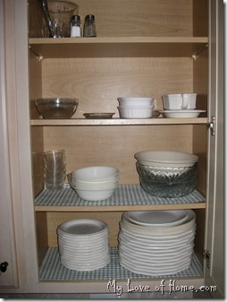 organized cabinet, white dishes