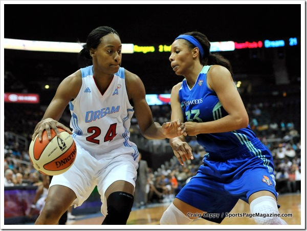 Sandora Irvin #24 of the Atlanta Dream drives baseline against Plenette Pierson #33 of the New York Liberty. (WNBA Women's Basketball: New York Liberty 94 v. Atlanta Dream 88. Philips Arena, Atlanta Ga. June 05, 2011)