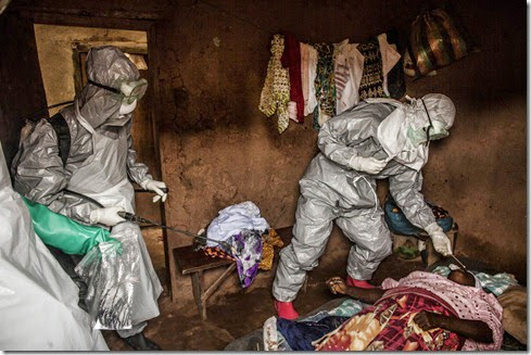 "Members of a Red Cross burial team take samples from a   woman suspected of dying of Ebola in the village of Dia on Monday, August 18, 2014. So-called ""safe burials,"" conducted by the International Federation of the Red Cross, are conducted in accordance with rigorous safety procedures. The dead bodies of Ebola victims are extremely infectious.(Pete Muller/Prime for the Washington Post)"