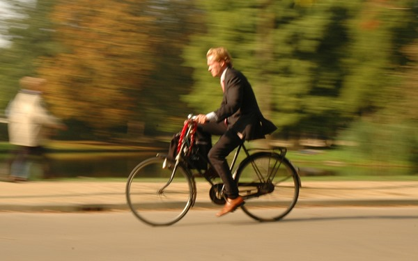 Amsterdam businessman commuting by bike