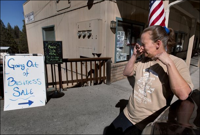 Pamela Harris sheds tears as she closes the doors of her Pine Mountain Deli after 10 years in business in Groveland, California, on the outskirts of Yosemite National Park. Businesses in the area of Yosemite National Park took a double hit as first the Rim Fire wildfire kept visitors away followed by the federal budget shutdown of the park. Photo: Randall Benton / MCT