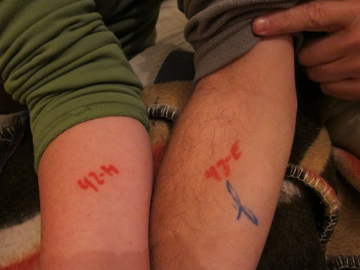 Our San Pedro Prison tattoos - marks used by the guards to identify tourists.