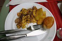 Saltfish and Ackee, breadfruit, and johnny cakes
