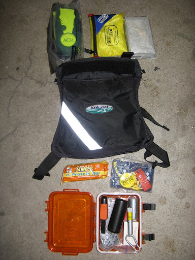 Ditch Kit  ACR Terra Fix 406 EPIRB Adventure Medical Ultralight .3 First Aid Kit Silver mylar blanket Energy Bar / Meal Replacement Signal mirror Drybox with: Tinder Fire starter (spark producing doo-dah) Storm matches (primary or back-up?) Duct tape (medical) Laser signaling device