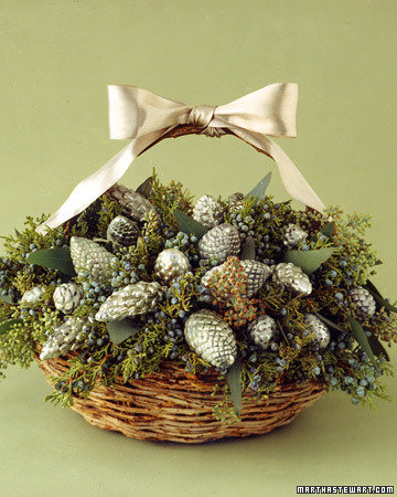 Vintage or new silver ornaments give a table luster. These pinecone-shaped examples are nestled in a basket, clustered among eucalyptus leaves and sprigs of cedar. Juniper enriches the frosty colors of the arrangement, as the blue-gray berries play off the silver ornaments.