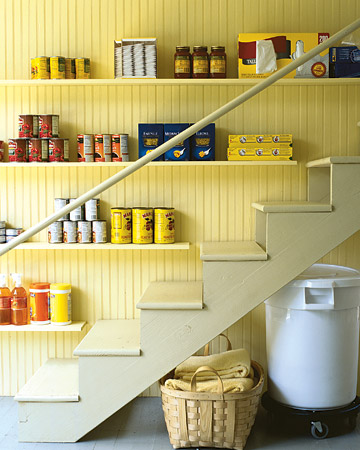 If the stairs leading to your cellar are wide enough, the wall beside them can be transformed into a pantry for items you use regularly, such as canned goods and other kitchen supplies.