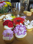 APRIL SHOWERS BRING MAY FLOWERS: Terri Trespicio, host of Whole Living on Martha Stewart Living Radio chooses to embellish her cupcakes with fresh flowers. Her cupcakes are topped with carnations and daisies.