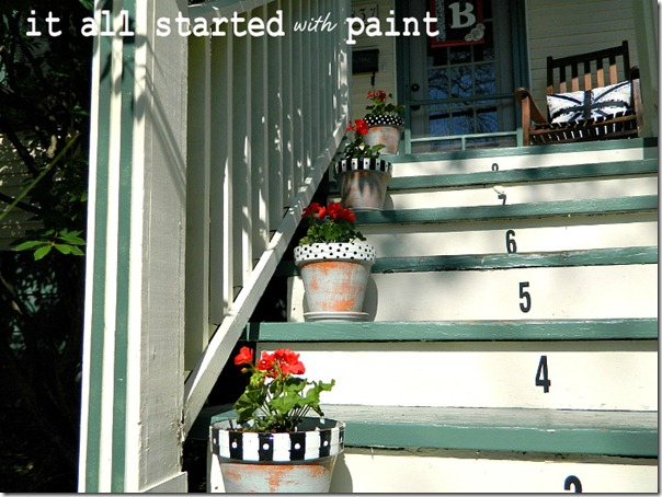 polka_dot_and_striped_painted_planters_on_porch_steps