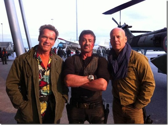 Arnold Schwarzenegger, Sylvester Stallone and Bruce Willis. From Arnie's Twitter account: Back in action for The Expendables 2! I'm having a fantastic time on set with Bruce and Sly in Bulgaria.