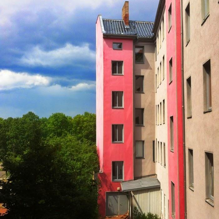 pink buildings stormy sky