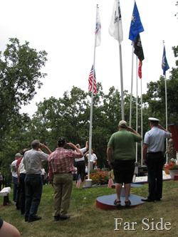 cousin Elmer raising the American Flag