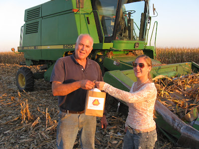 "4-H'er and County Council member Shari Temple found Jay Crone combining in a corn field where he stopped for his ""Stay Safe, Take a Break"" bag.  Photo courtesy:  Washington County Extension."