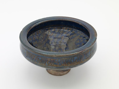 Bowl | Origin:  Iran | Period: late 14th century  Il-Khanid period | Details:  Not Available | Type: Stone-paste decorated with lustre over deep blue glaze | Size: H: 11.4  W: 21.4  cm | Museum Code: F1909.313 | Photograph and description taken from Freer and the Sackler (Smithsonian) Museums.