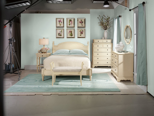 A photo from the set featuring Martha Stewart Living's Ingrid Collection - some of my favorites include: the upholstered bench, scalloped mirror and tall dresser.
