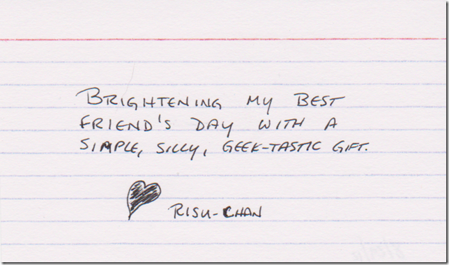 Brightening my best friend's day with a simple, silly, geek-tastic gift. (A heart, drawn & colored in black pen, and the name Risu-chan.)