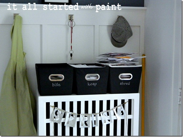 mail_sorting_bins_at_entryway