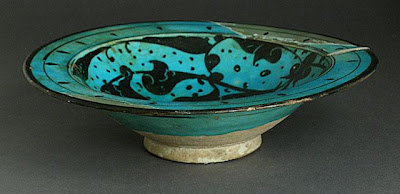 Bowl | Origin: Syria | Period: late 12th-early 13th century | Collection: The Madina Collection of Islamic Art, gift of Camilla Chandler Frost (M.2002.1.75) | Type: Ceramic; Vessel, Fritware, underglaze-painted and incised, 2 7/8 x 10 5/8 in. (7.3 x 26.98 cm)
