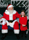 Annual Santa visit.  She was very talkative and cordial, but that's as close as she would get. (December)