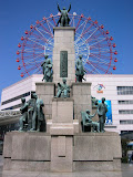 "The plaque for this statue reads, in part: ""Satsuma, now Kagoshima, produced brilliant, far-sighted men during the Meiji Restoration (1868). In 1865, defying the Tokugawa Isolation Law, 17 courageous young students from Satsuma were smuggled to Europe and America to learn advanced Western technology. Overcoming great difficulties, they returned to become the driving force in the modernization of the feudalistic society."""