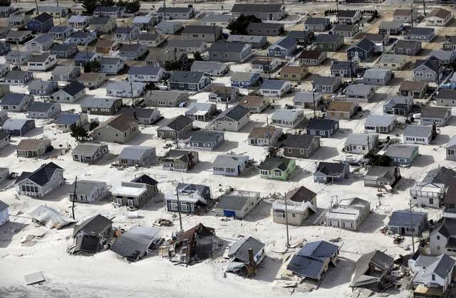 Sand fills the streets along the central Jersey shore in the wake of superstorm Sandy. Photo: MIKE GROLL / Associated Press