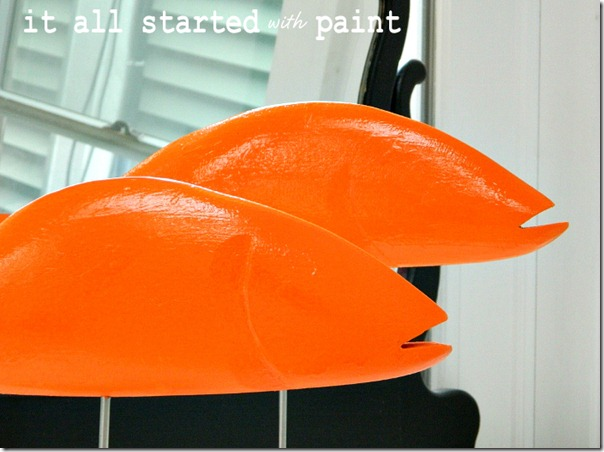 fish_painted_orange_on_sticks
