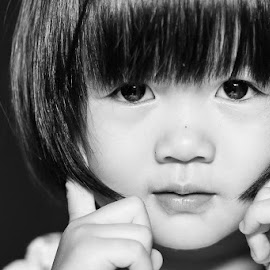 The Pose by Wei Fuk Lie - Babies & Children Child Portraits ( face, pose, girl, black and white, daughter, bw, kid )