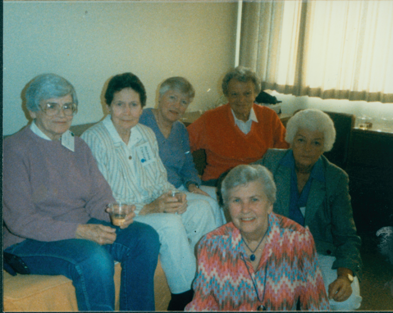 Donna Smith and friends at the Older Lesbian Conference, West Coast. The people are identified as Donna (crouched in front), Jo, Billy, Nina, Barbara, and Pat. August 4-6, 1989.