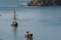 Tall ship and fishing boat