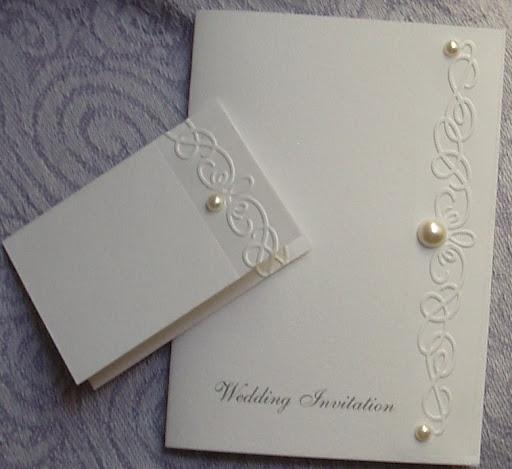 Elegant Swirls and Pearls Hand Embossed Wedding invitations on a Soft Velvet
