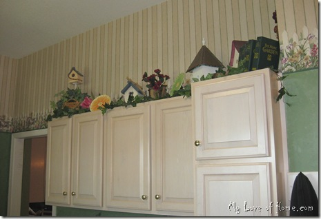 Maple cabinets, bird houses, green walls,