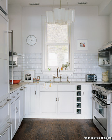To achieve a feeling of openness, this Chicago row-house kitchen was washed in a clean, pale palette.