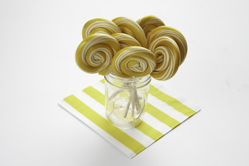 These big playful lollipops (in the sale) can be put individually on place settings or placed in ball jars on the candy buffet. The striped paper napkins are in the sale too.
