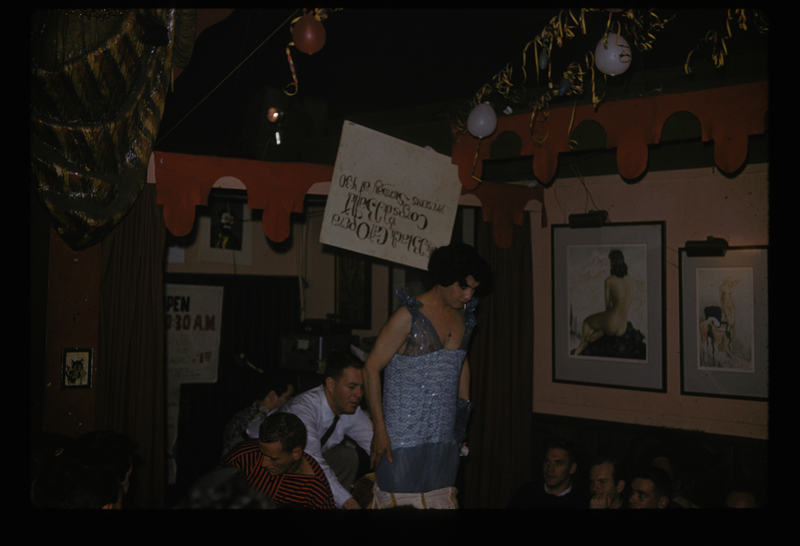 Jose Sarria performs a drag show at the Black Cat Bar. Circa early 1960s.