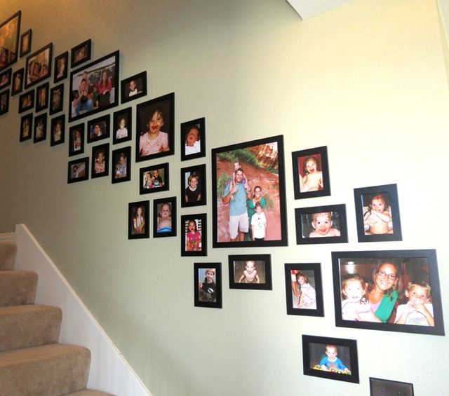 use velcro to hang pictures on stairway 4