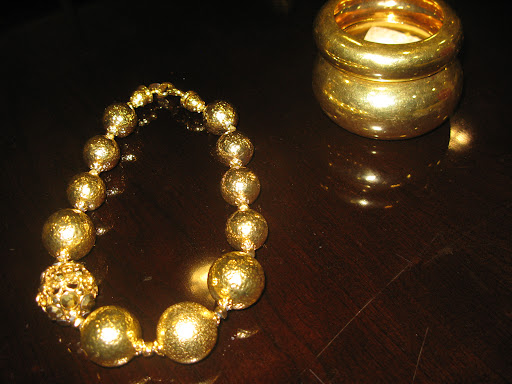 Necklace from Barrera and bracelets from Alexis Bittar.