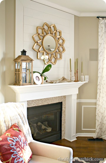 wood plank wall fireplace starburst mirror