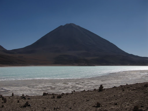 Lifeless Laguna Verde and Volcano Licancabur, marking the Chilean border in the background.